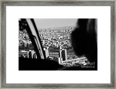 Helicopter Flies Over Harlem And East River New York City Framed Print by Joe Fox