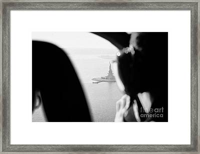 Helicopter  Flies Over Statue Of Liberty As Seen Through The Plexiglas New York Framed Print