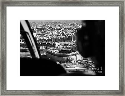 Helicopter  Flies Over Yankee Stadium New York City Framed Print by Joe Fox