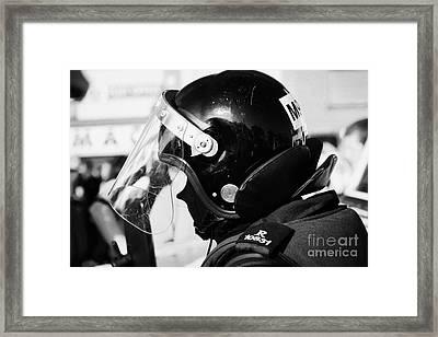 Helmet Of Psni Riot Officer Head And Shoulders On Crumlin Road At Ardoyne Shops Belfast 12th July Framed Print by Joe Fox