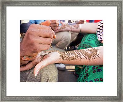 Henna Being Applied On Woman's Hand Framed Print by David H. Wells