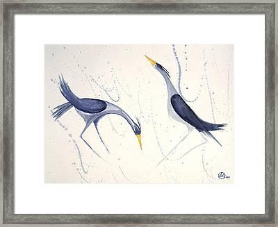 Herons In The Rain Framed Print