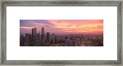 High Angle View Of A City At Sunset Framed Print