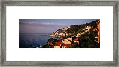 High Angle View Of A City Near The Sea Framed Print