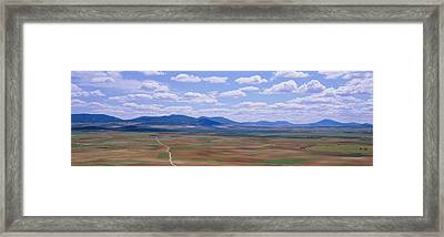 High Angle View Of A Dirt Road Passing Framed Print