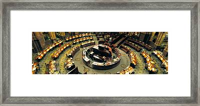 High Angle View Of A Library Reading Framed Print