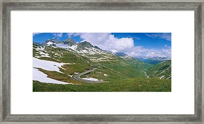 High Angle View Of A Road Passing Framed Print by Panoramic Images
