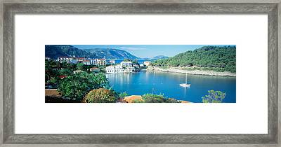 High Angle View Of A Town On The Framed Print by Panoramic Images
