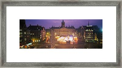 High Angle View Of A Town Square Lit Framed Print by Panoramic Images