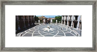 High Angle View Of A Town Square Framed Print