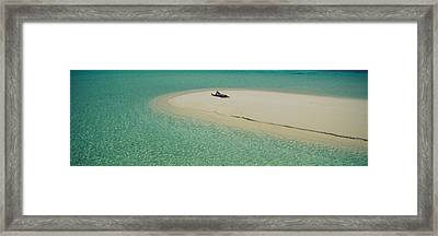 High Angle View Of A Woman Sunbathing Framed Print