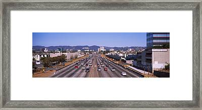 High Angle View Of Cars On The Road Framed Print