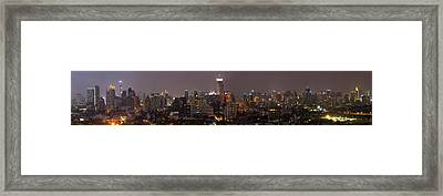 High Angle View Of City At Dusk Framed Print