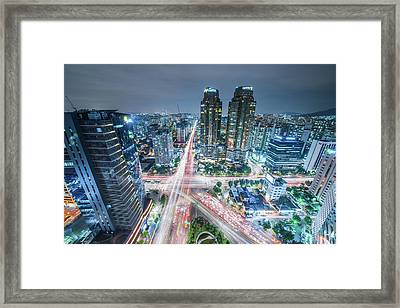 High Angle View Of Cityscape Lit Up At Framed Print by Gangil Gwon / Eyeem