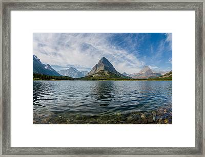 High Clouds Over Swiftcurrent Lake Framed Print by Greg Nyquist