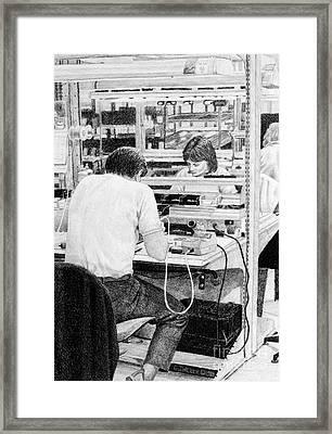 High Tech Gluers Framed Print by Gordon J Weber