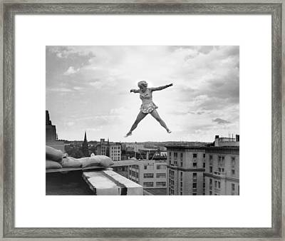 High Up Acrobatics Framed Print by Underwood Archives