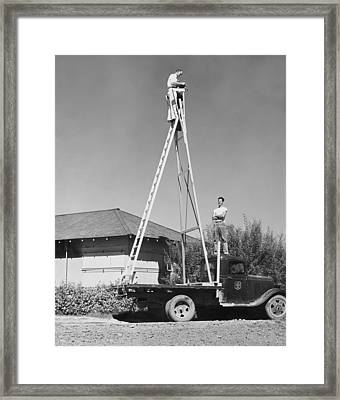 High Up Photographer Framed Print by Underwood Archives