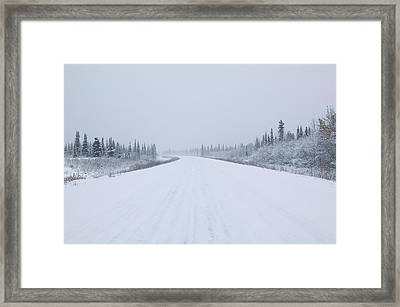 Highway Passing Through A Snow Covered Framed Print by Panoramic Images