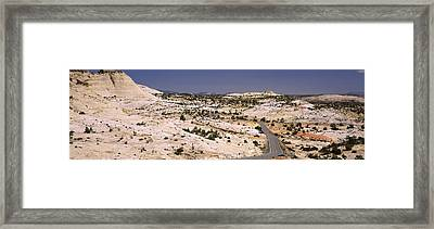 Highway Passing Through An Arid Framed Print by Panoramic Images
