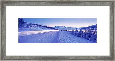 Highway Running Through A Snow Covered Framed Print by Panoramic Images