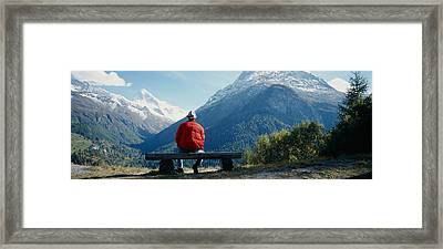 Hiker Contemplating Mountains Framed Print by Panoramic Images