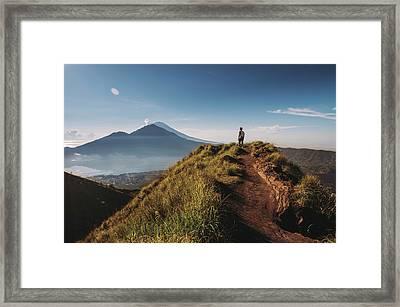 Hiker Staying On Top Of  Mount Batur Framed Print by Alex Grabchilev / Evgeniya Bakanova
