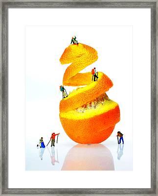 Hikers Climbing Orange Mountain Framed Print by Paul Ge