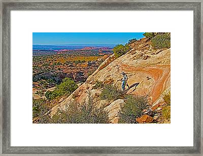 Hiking Down Steep Slickrock Of Aztec Butte Trail In Island In The Sky In Canyonlands Np-utah Framed Print by Ruth Hager