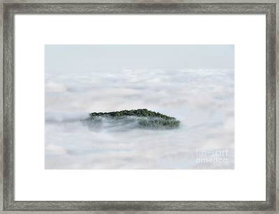 Hill Top Island In The Clouds Framed Print by Dan Friend