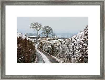 Hill Top Lane In Snow Framed Print by Pete Hemington