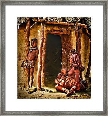 Himba Family By The Door Of Their Clay Hut Framed Print by Paul W Sharpe Aka Wizard of Wonders