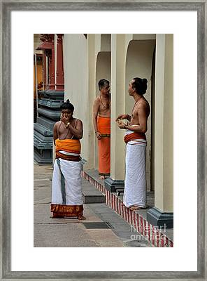 Hindu Priests Relax After Morning Rituals Singapore Framed Print by Imran Ahmed