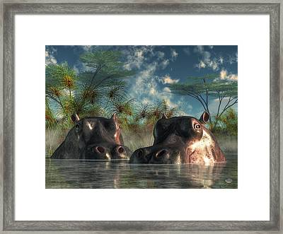 Hippos Are Coming To Get You Framed Print by Daniel Eskridge