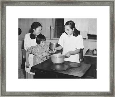 Hirohito's Daughters Cooking Framed Print by Underwood Archives