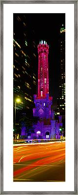 Historic Water Tower Lit Up At Night Framed Print by Panoramic Images
