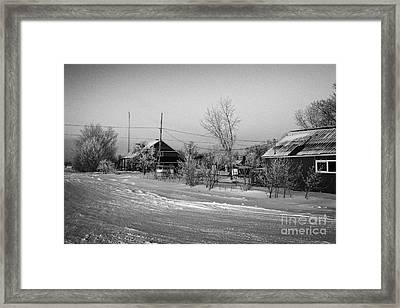 hoar frost covered street in small rural village of Forget Saskatchewan Canada Framed Print by Joe Fox