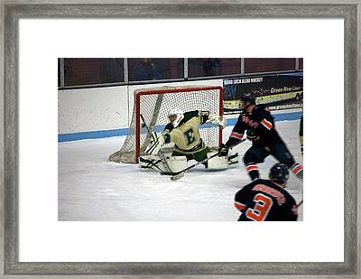 Hockey Off The Handle Framed Print by Thomas Woolworth