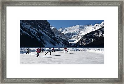 Hockey Players Playing On The Frozen Framed Print