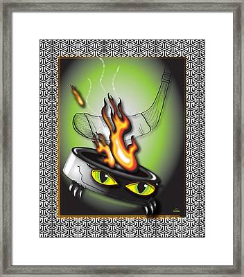 Hockey Puck In Flames Framed Print