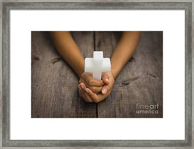 Holding A Religious Cross Framed Print by Aged Pixel