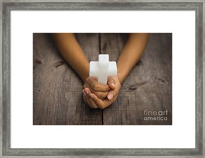 Holding A Religious Cross Framed Print