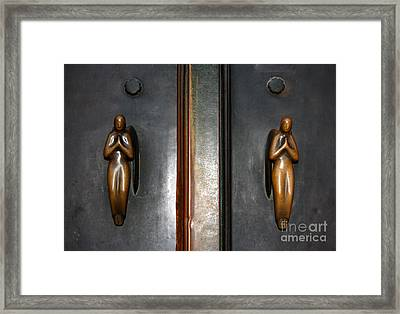 Holding Angels Framed Print