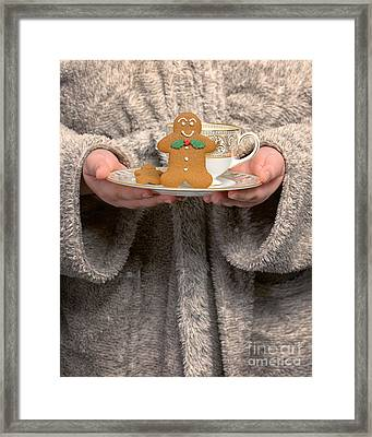Holding Gingerbread Biscuits Framed Print by Amanda Elwell
