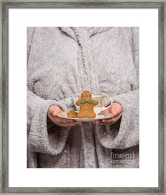 Holding Gingerbread Framed Print by Amanda Elwell