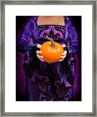 Holding Pumpkin Framed Print by Amanda Elwell