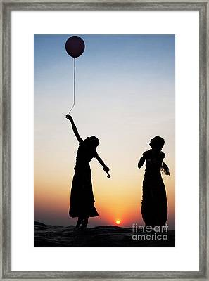 Holding The Dream Framed Print