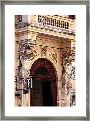 Holding Up In Rome Framed Print by John Rizzuto