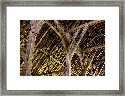 Holding Up The Roof Framed Print