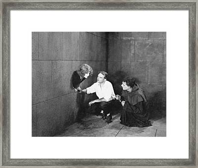 Hole In The Wall Woman Framed Print by Underwood Archives